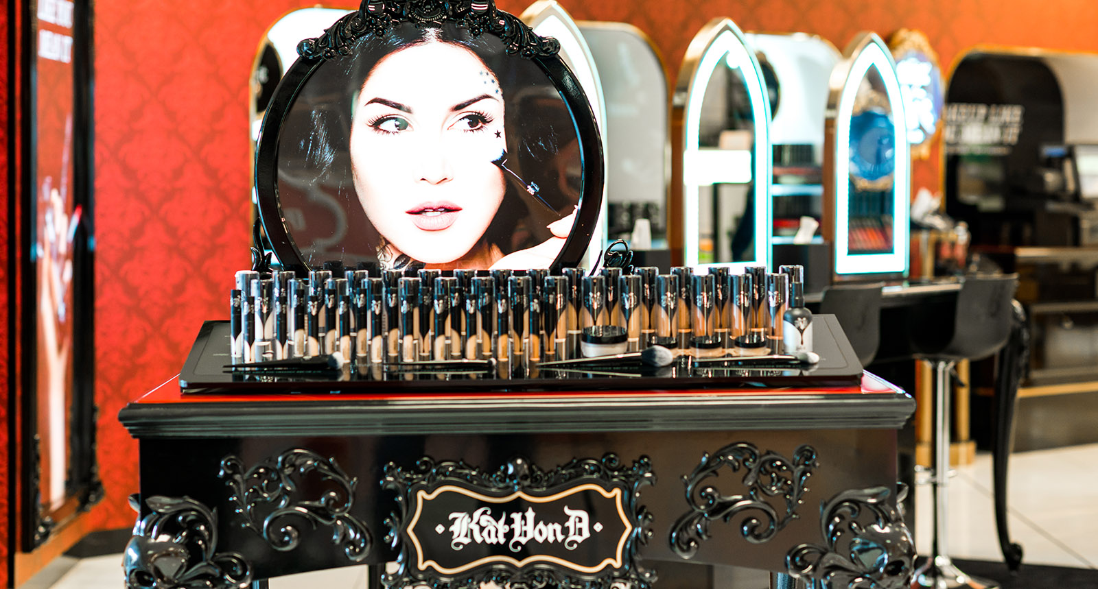 Makeup table with photo of Kat von D