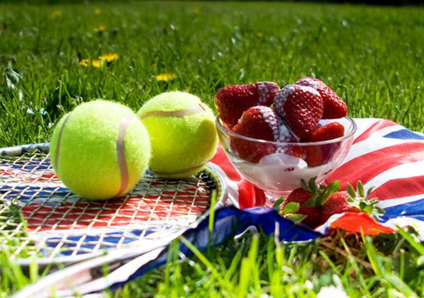 Tennis Balls, Racket and Strawberries