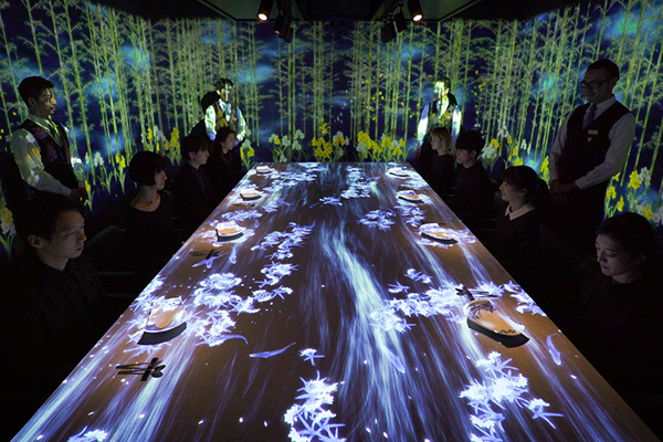 Japanese art collective teamLab has produced an immersive experiences that responds to the movements of diners'