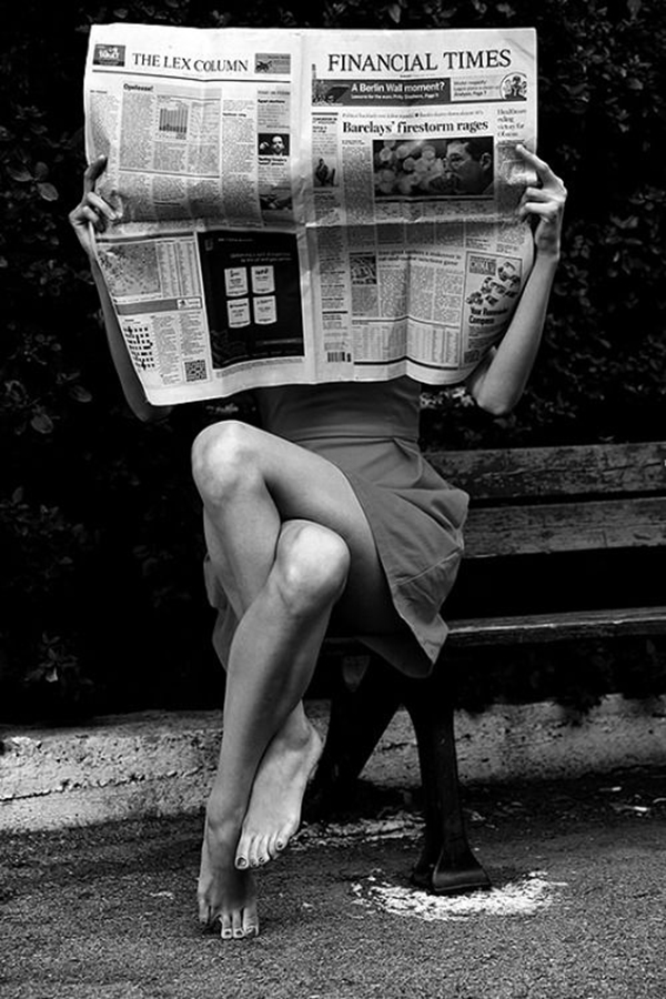Woman reading financial times newspaper
