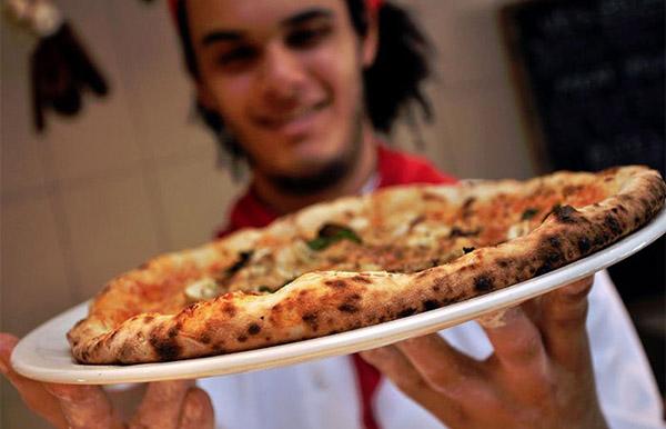 Man holding Franco Manca Pizza