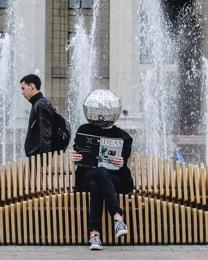 woman with discoball head